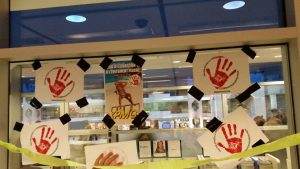 A photograph of red hand signs.