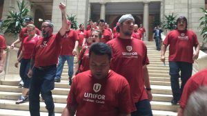 Unifor union members protest Bill 7 in the Legislature.
