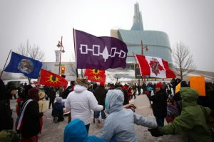 Photo of a round dance in front of the Canadian Museum for Human Rights